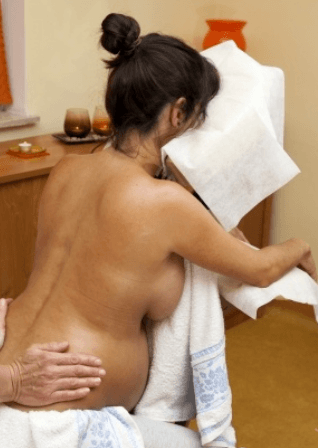 doing massage for a pregnant woman sitting on chair