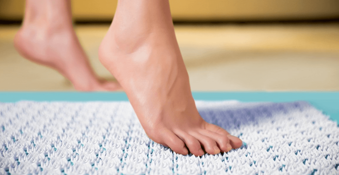 a woman is using an acupressure Mat