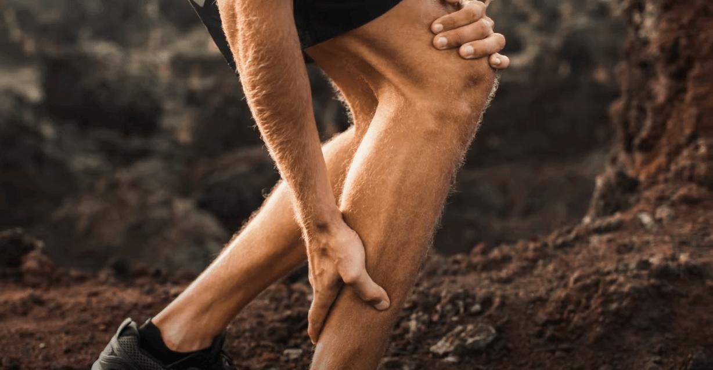 the man feeling pain in the leg