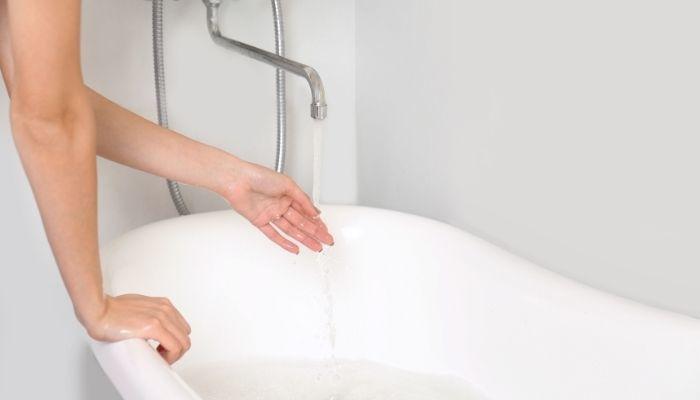 take a bath in warm water