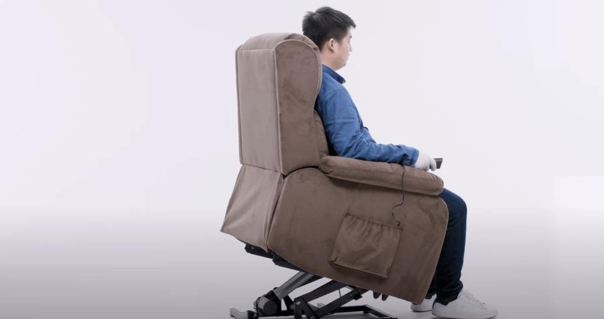 A man is using a lift recliner