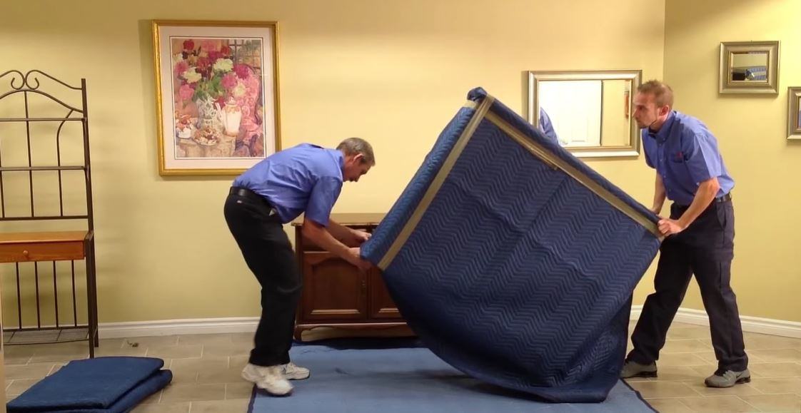 Men are moving a furniture
