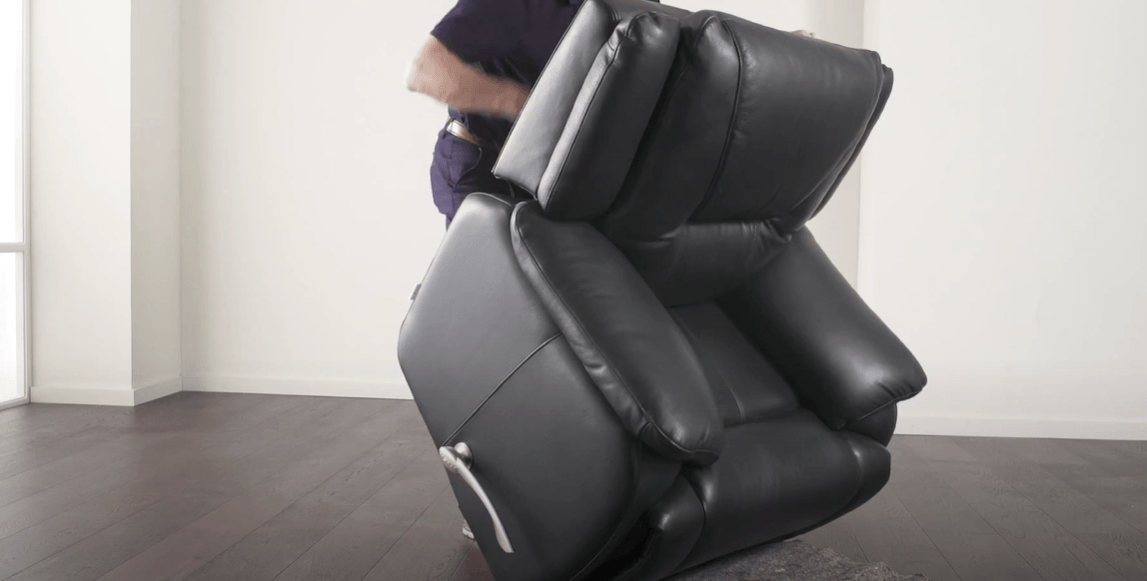 a man is moving a recliner