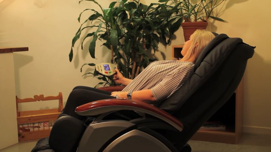 a woman is relaxing on massage chair