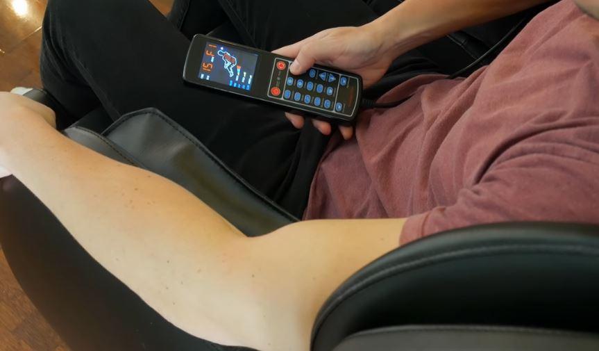 man resting on massage chair