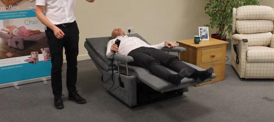 man sleeping in a recliner