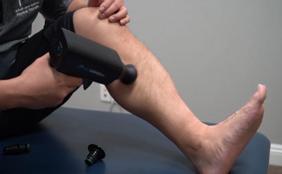 using a massage gun for calf relief