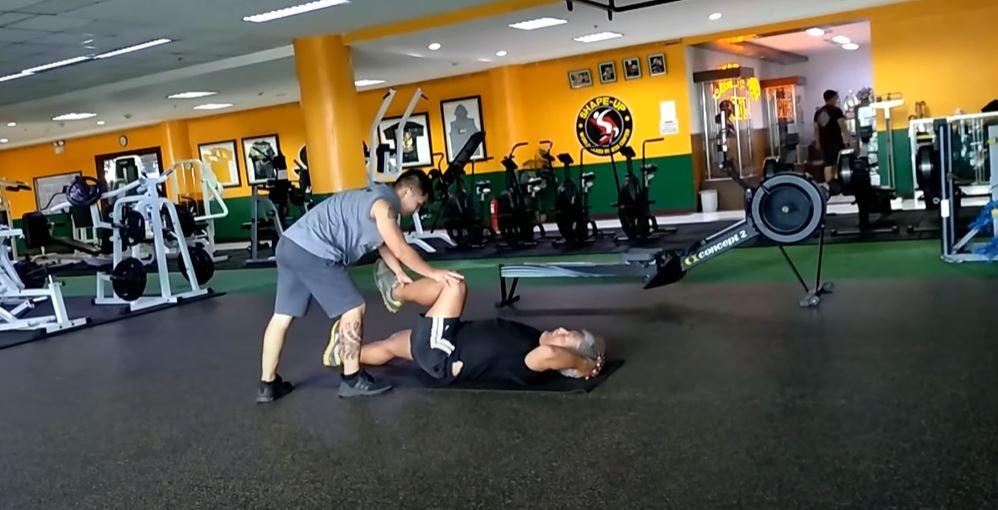 a man getting massage after workout