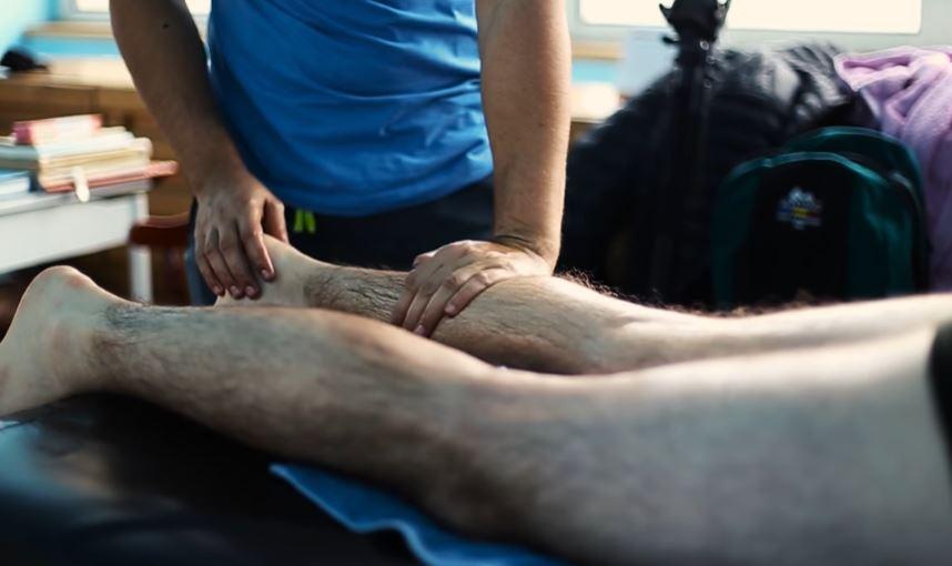 a man getting deep tissue massage treatment