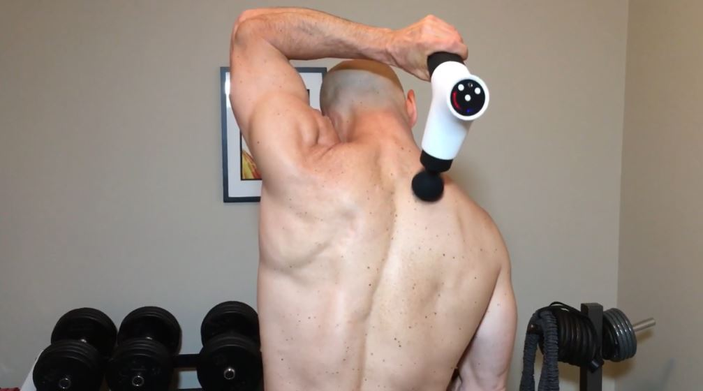 using massage gun for back pain relief