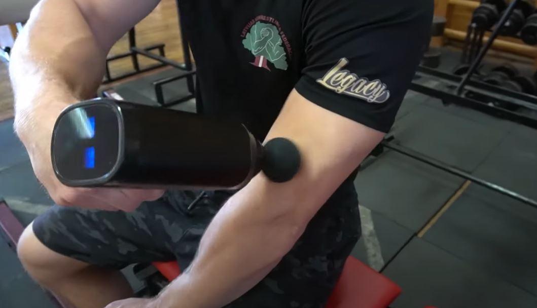 Man using massage gun